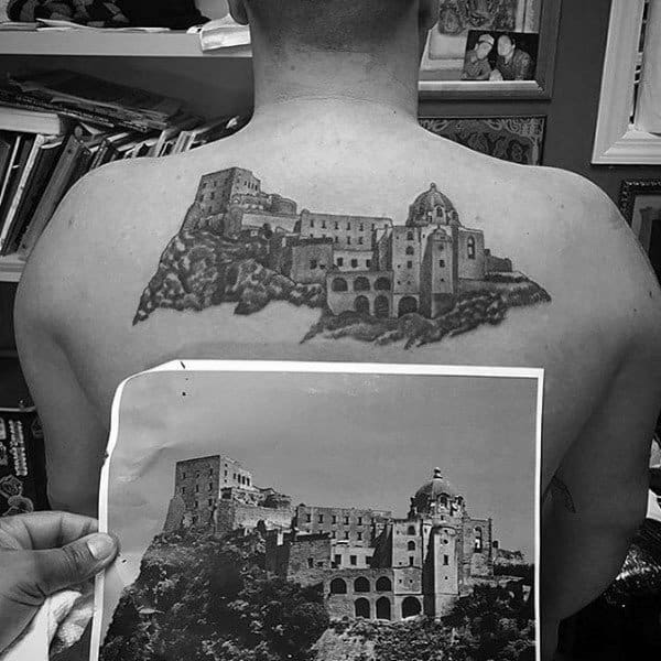 Scottish Castle On Mans Back Tattoo Design