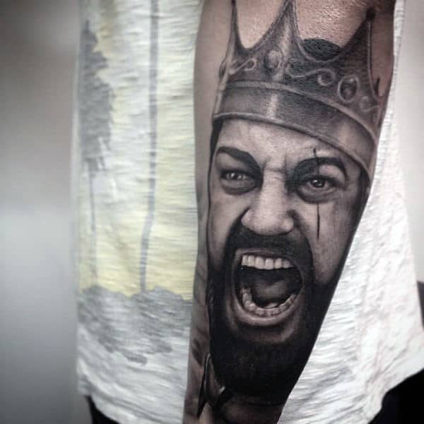 Screaming Man With Crown Tattoo On Arms For Men