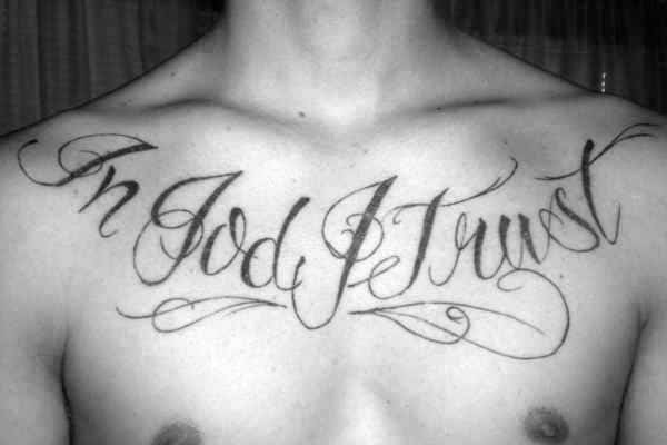 Script In God We Trust Male Upper Chest Tattoos