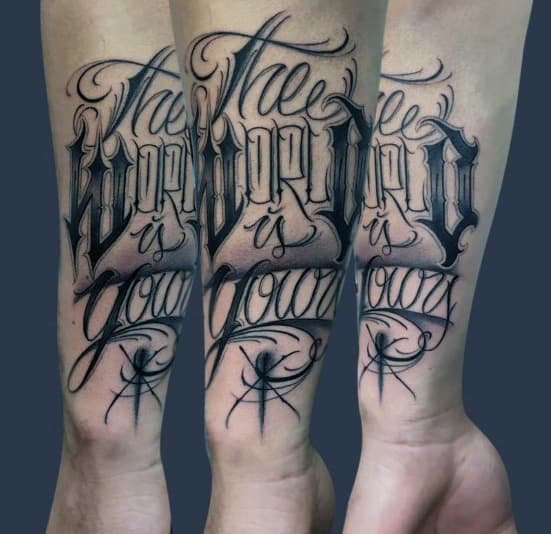 Script The World Is Yours Mens Forearm Tattoos