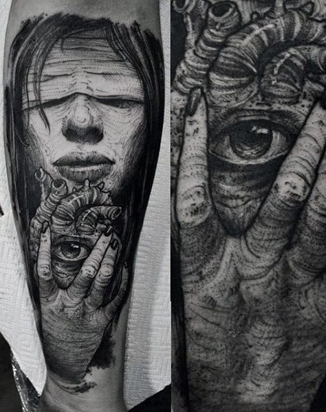 Seeing Heart Tattoo On Man Held By Corpse Black Ink On Forearm
