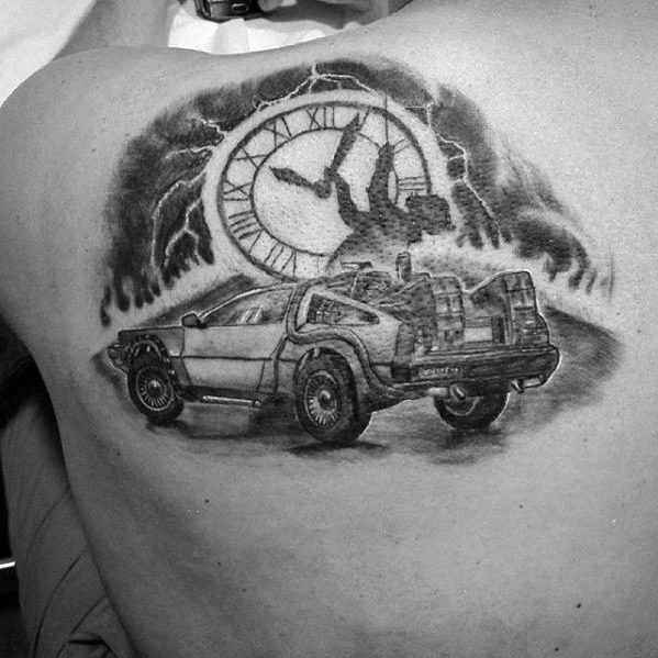 Shaded Black And Grey Back To The Future Mens Delorean Clock Tattoo On Upper Shoulder
