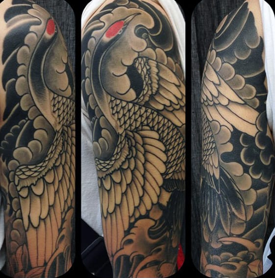 Shaded Black And Grey Clouds With Japanese Crane Mens Sleeve Tattoo