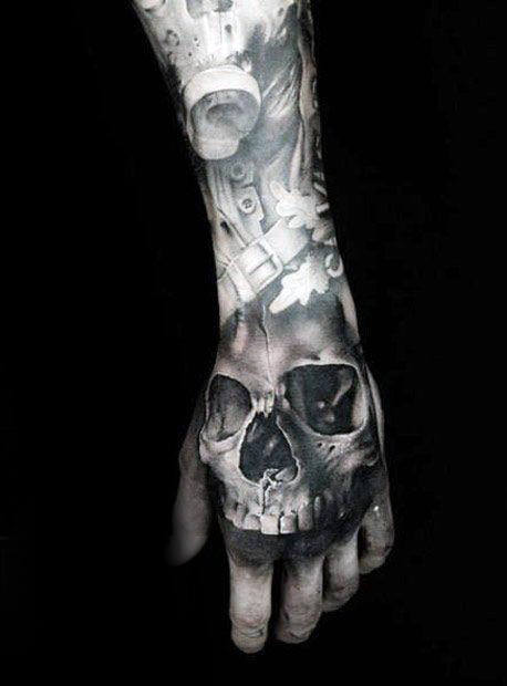 Shaded Black And Grey Cool Skull Tattoo On Mans Hand