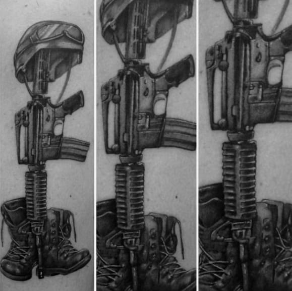 Shaded Black And Grey Fallen Soldier Cross Mens Arm Tattoo