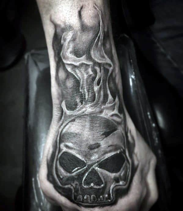 Shaded Black And Grey Hand Flaming Skull Guys Tattoos