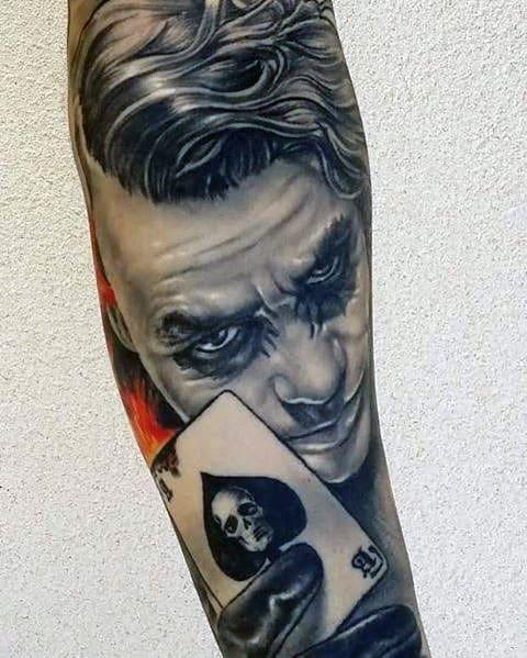 Shaded Black And Grey Ink Joker Sleeve Tattoo On Guy