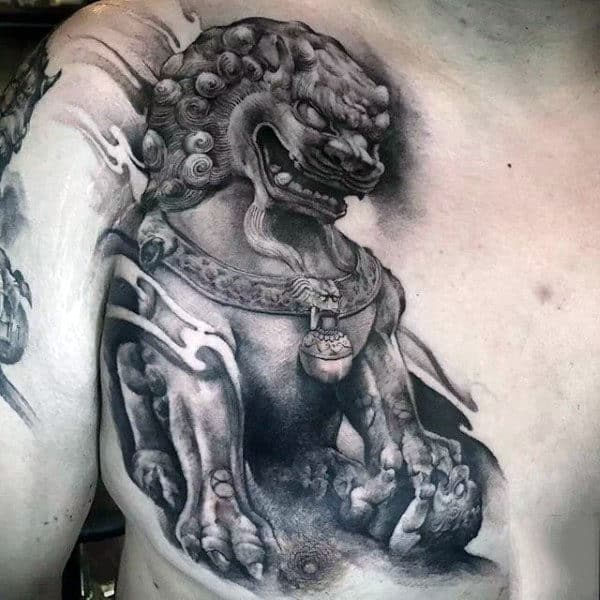 Shaded Black And Grey Ink Statue Tattoo Of Foo Dog On Man