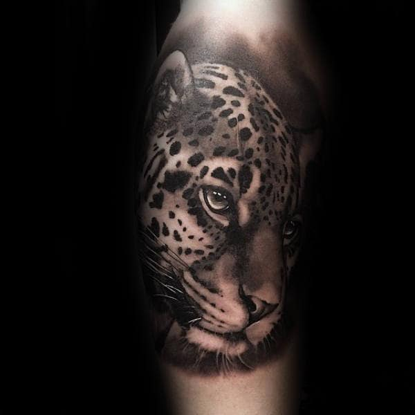 Shaded Black And Grey Leopard Male Tattoo On Forearm