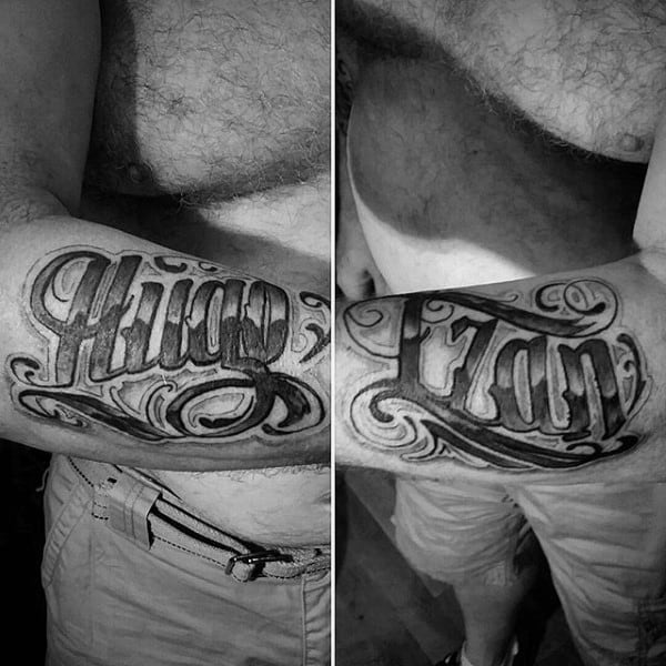 Shaded Black And Grey Male Name Tattoo On Outer Forearm