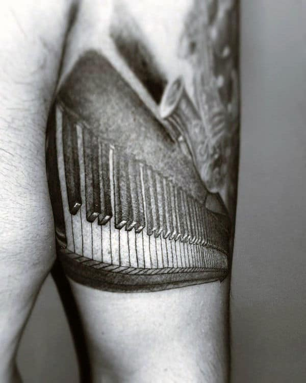Shaded Black And Grey Male Piano Tricep Tattoo