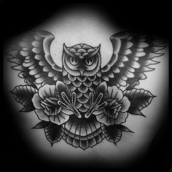 Shaded Black And Grey Traditional Owl Upper Back Tattoo On Guy