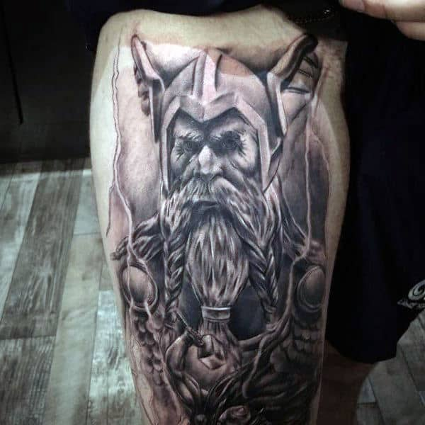 Shaded Black And White Ink Male Odin Tattoo Design On Thighs