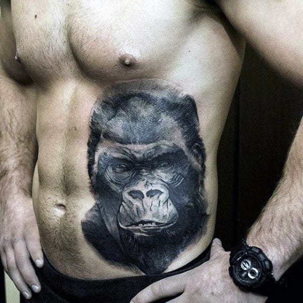 Shaded Black Ink Guys Insane Gorilla Face Tattoo On Rib Cage Side