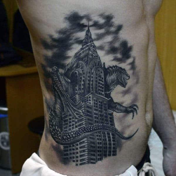 shaded-blackwork-tattoo-of-godzilla-crushing-skyscraper-on-mans-side
