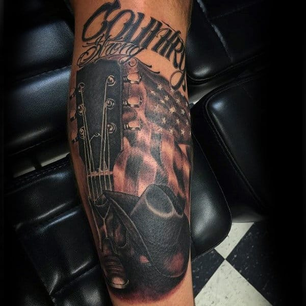Shaded Country Guitar American Flag Cowboy Hat Tattoo On Guy