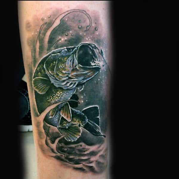 Shaded Dark Bass Tattoo With Black Background On Guy