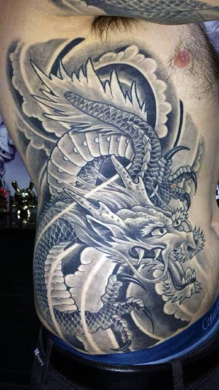 Shaded Grey Chinese Dragon Mens Rib Cage Side Of Body Tattoo