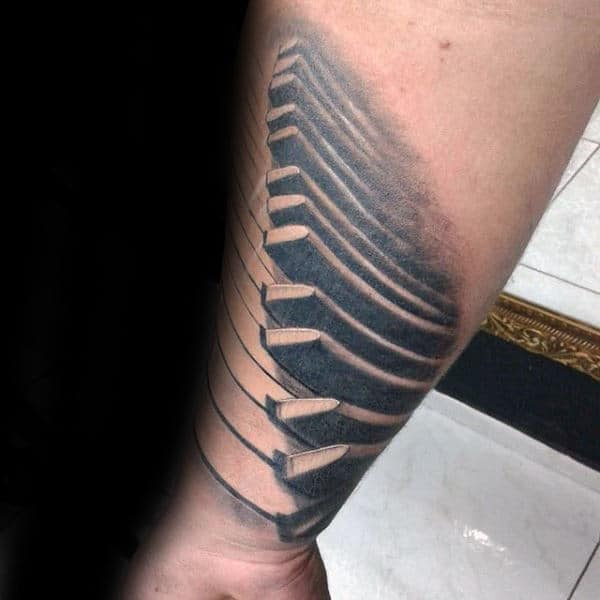 Shaded Grey Ink Male Tattoo Of Piano Keys On Forearms