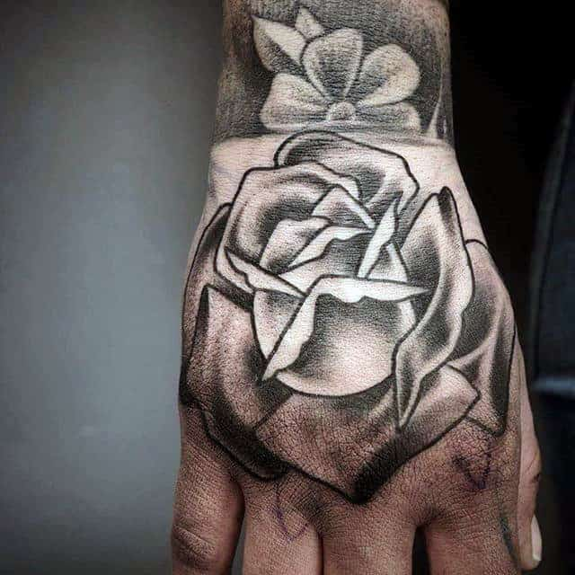 Shaded Hand Black Rose Male Tattoo