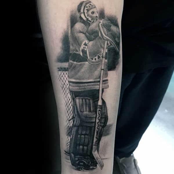 Shaded Hockey Player Tattoo On Males Inner Forearm