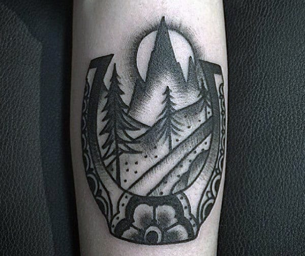 Shaded Old School Mens Horseshoe Tattoo With Forest Design