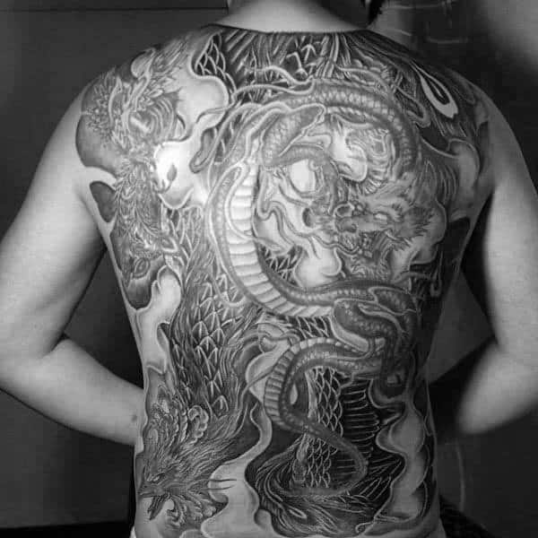 Shaded Phoenix And Dragon Tattoo On Males Back