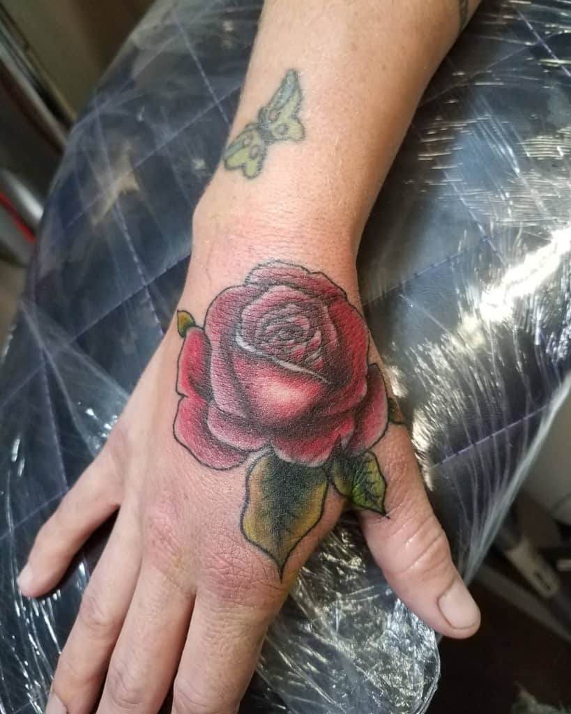 shaded rose hand tattoos ironandinktattoos420