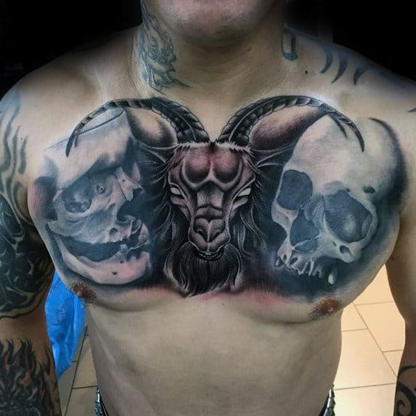 Shaded Skulls With Goat In Middle Mens Chest Tattoo