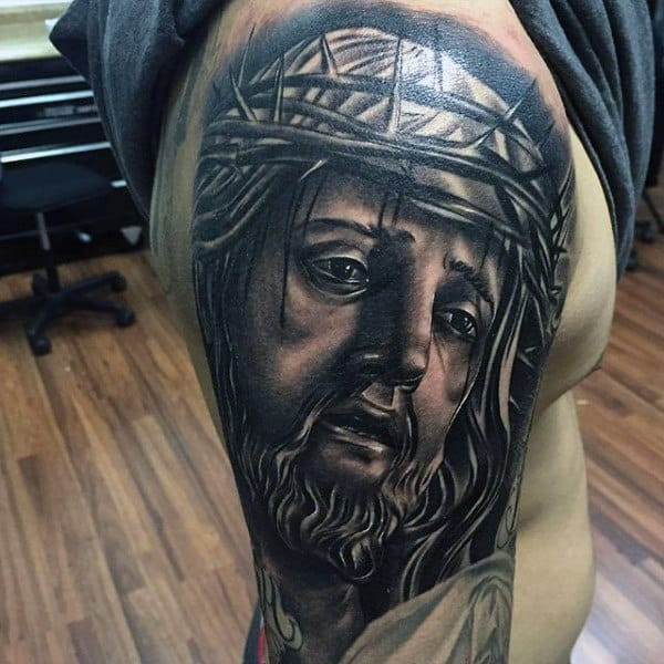 Shaded Upper Arm Jesus Christ Tattoo On Male
