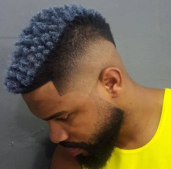 A two-toned frohawk with faded sides