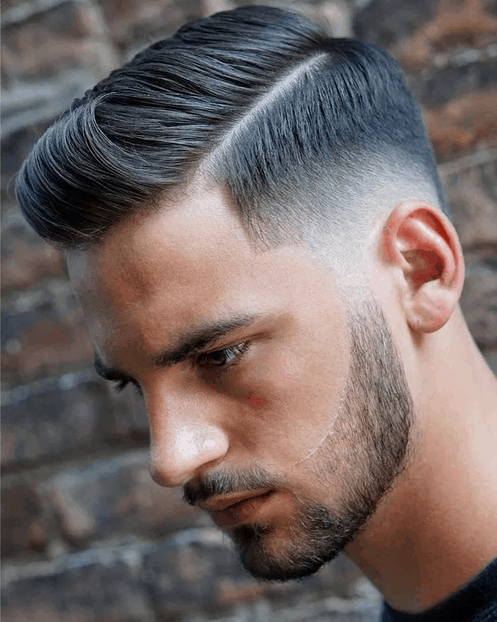 Hair styled into two proportional hair lengths and a low fade