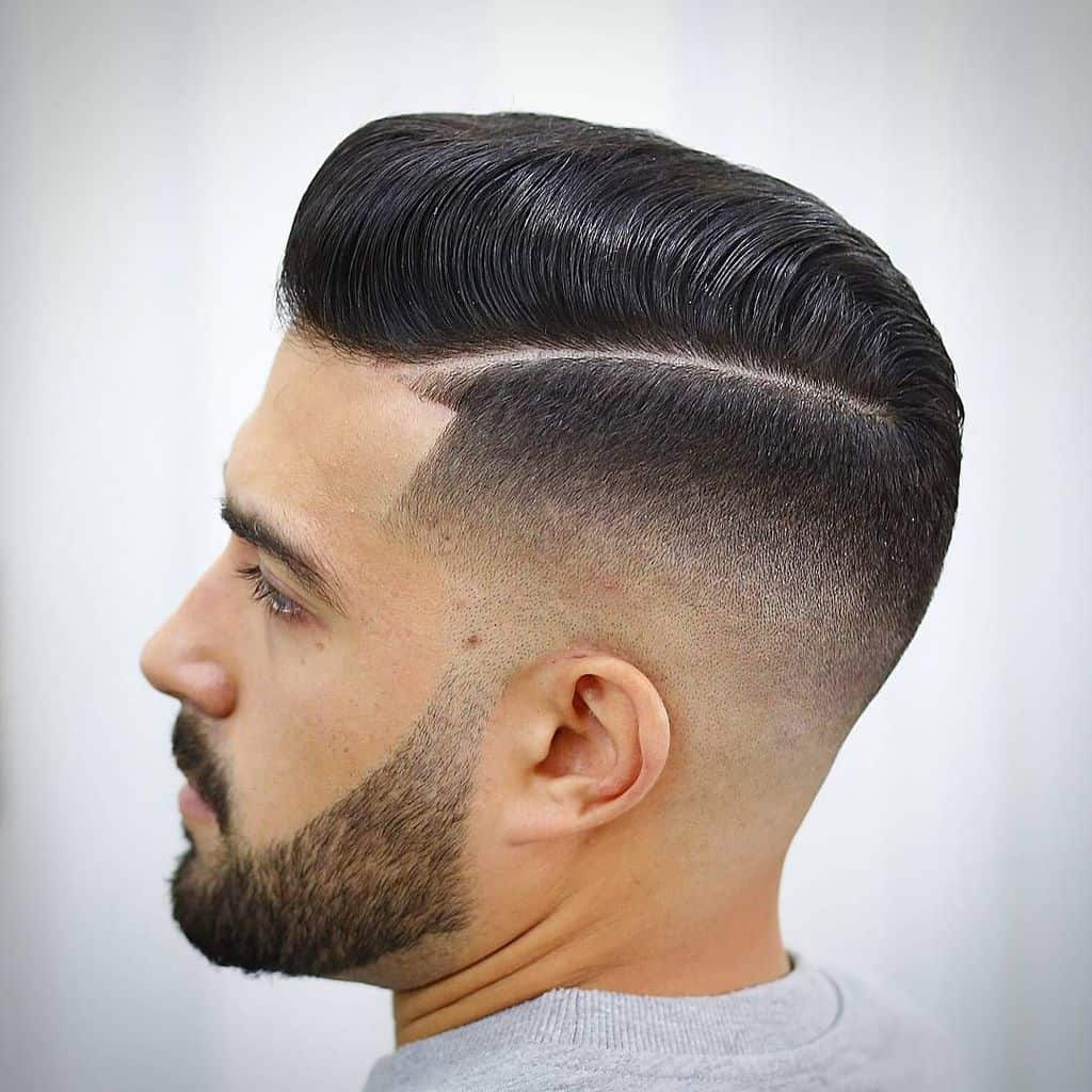 A pompadour fade with a clean line and faded sides