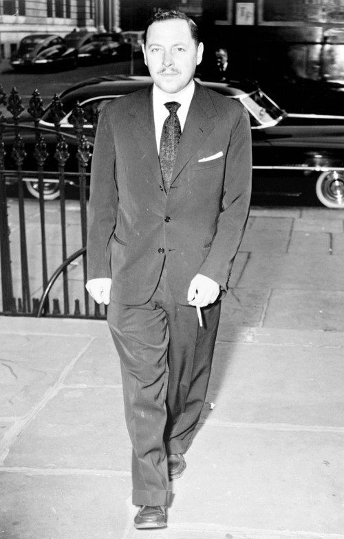 Sharp Black Suit And Tie Mens Fashion From The 1950s Time Period