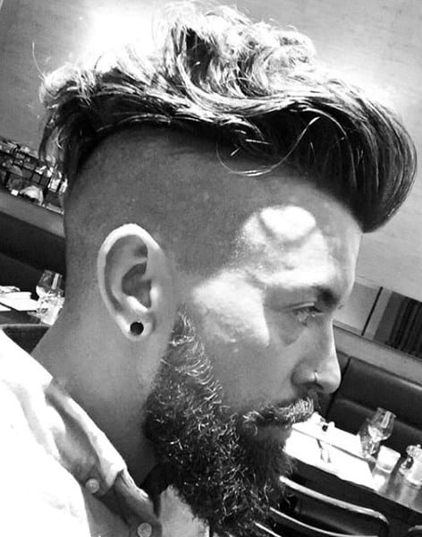 Shaved Sides Undercut Mens Wavy Haircut With Beard