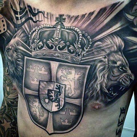 Sheild With Crown Guys Chest Tattoos