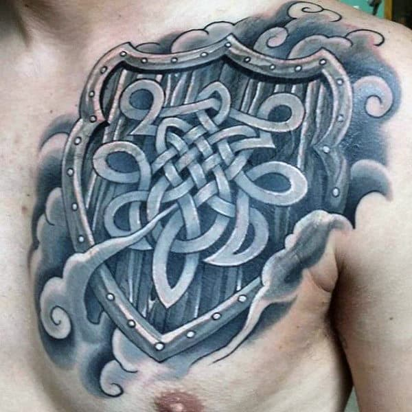 Shield With Celtic Knots And Clouds Mens Upper Chest Tattoos