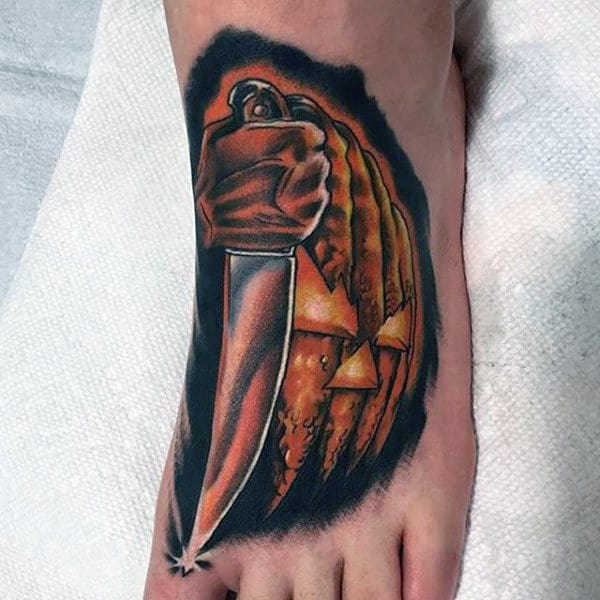 Shining Metallic Brown Knife Tattoo On Foot For Men