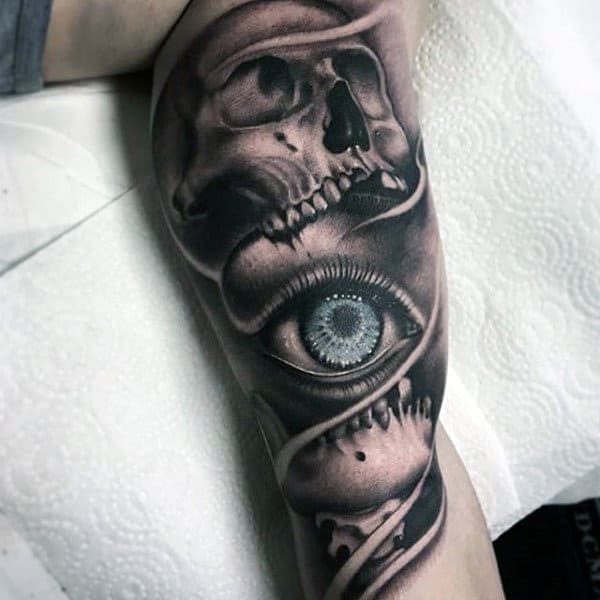 Shiny Blue Eye Inside Horrendous Skull Tattoo Mens Forearms