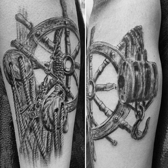 Ship Hook And Wheel Tattoos On Mans Forearm