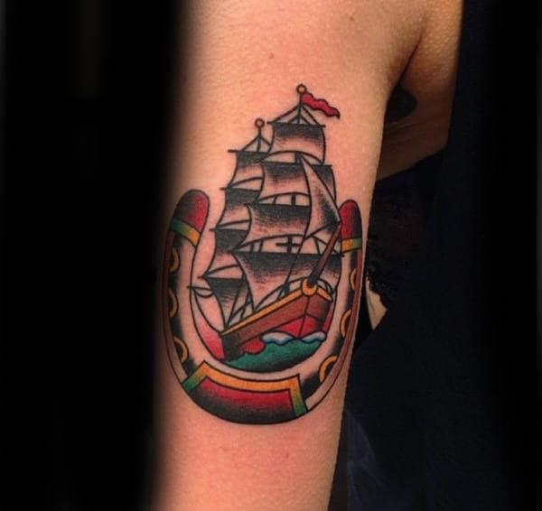 Ship Inside Horseshoe Male Arm Tattoo Ideas