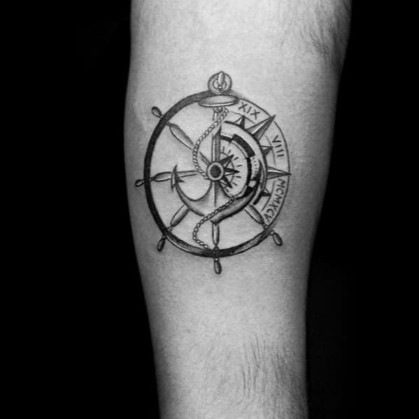 ship wheel with nautical star and anchor male small arm tattoo ideas