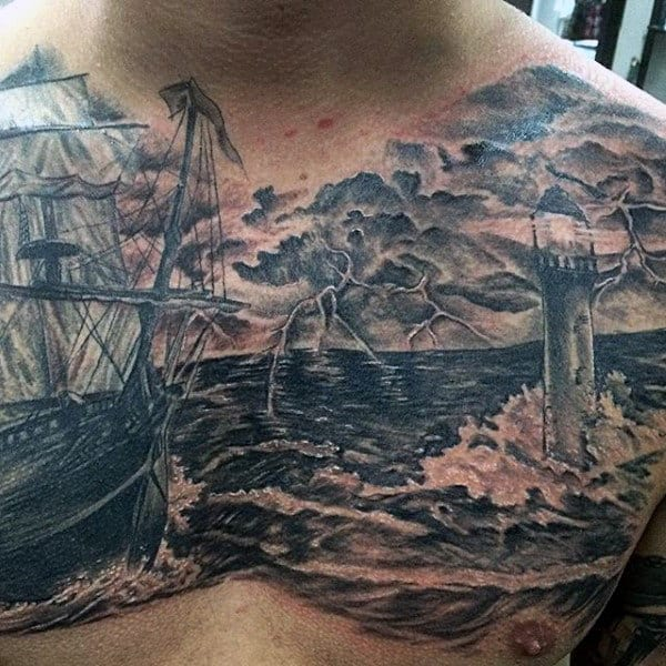 Ship With Thunder Lighthouse Tattoo On Mans Chest