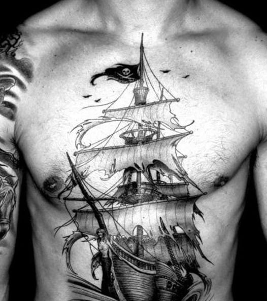 Ship With Torn Pirate Flags Mens Chest Tattoos