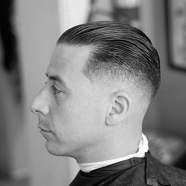 Short Length Mens Skin Fade Haircut Slicked Back