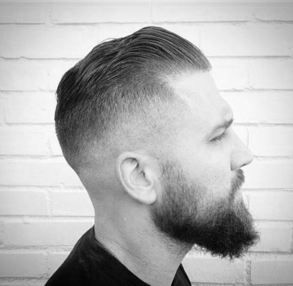 Short Length Slicked Back Skin Fade Haircut For Men