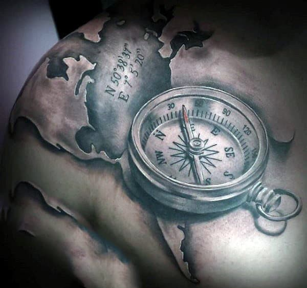 50 world map tattoo designs for men adventure the globe shoulder compass and world map tattoo for men gumiabroncs Image collections