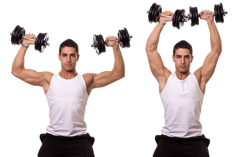 young man doing seated dumbbell shoulder press exercise