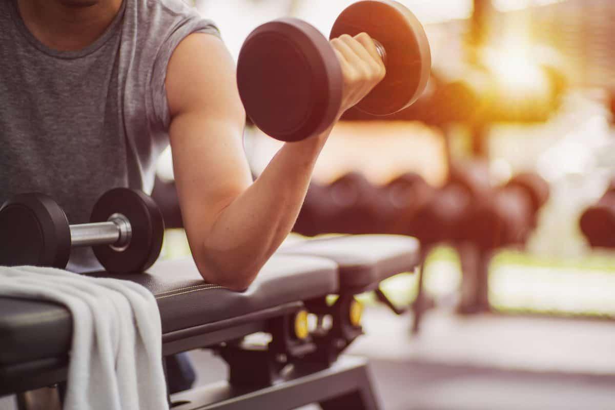 Muscular,Man,Detail,Lifting,Weights