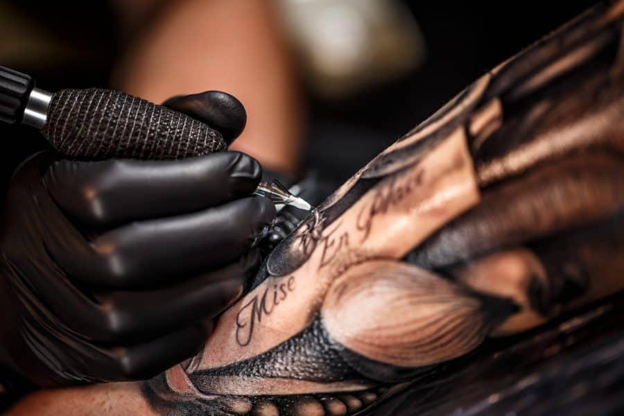 Tattoo Artist working close up